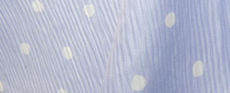水玉のポリエステル楊柳
